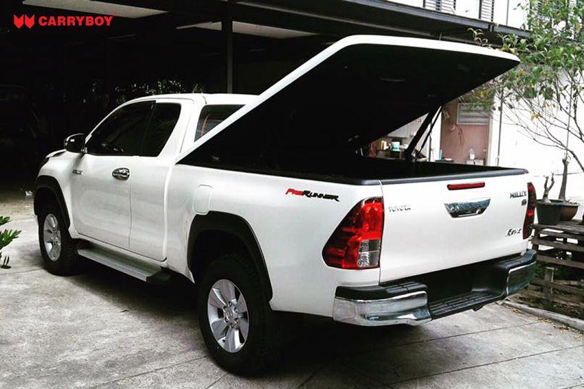 CARRYBOY Deckel in Wagenfarbe mit automatischem Motorhub Toyota Hilux Revo Invincible Extrakabine offen fahrbar