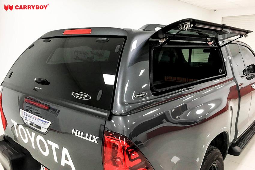 Toyota Hilux Revo Invincible Extrakabine Hardtop mit Klappfenster CARRYBOY