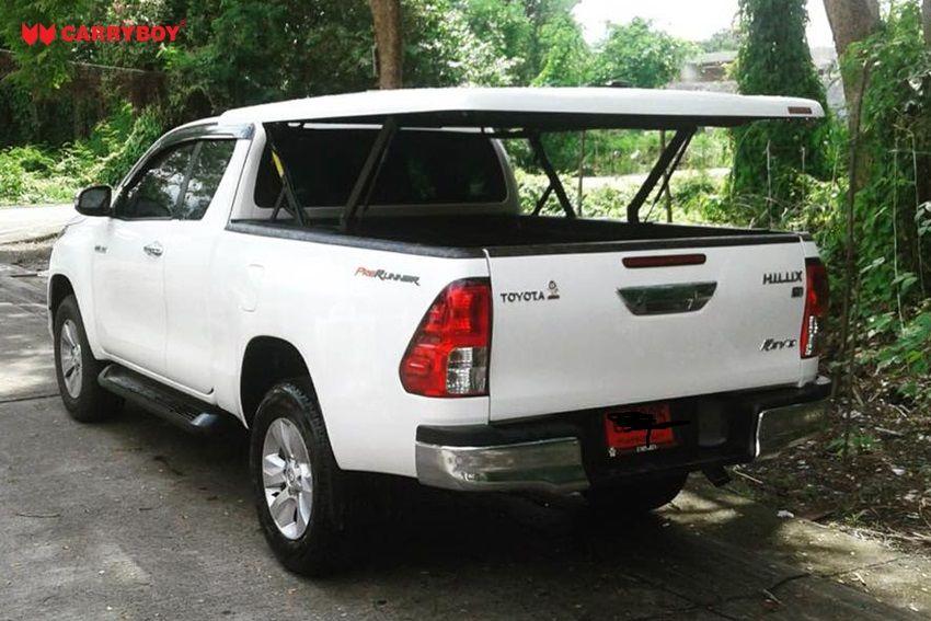 CARRYBOY Deckel in Wagenfarbe mit automatischem Motorhub Toyota Hilux Revo Invincible Extrakabine