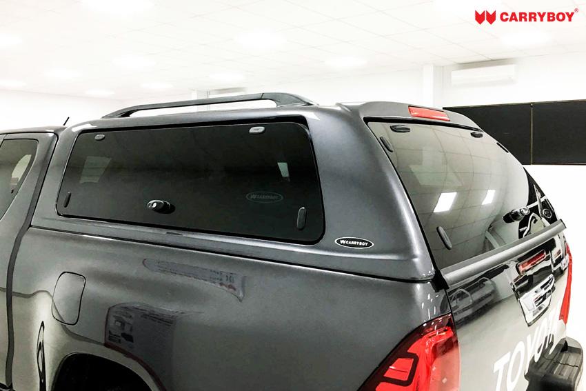Toyota Hilux Revo Invincible Extrakabine Hardtop in Wagenfarbe CARRYBOY